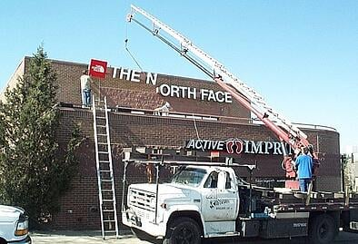Installation of a sign for The North Face