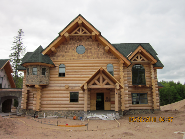 New Frontier Log Home finishing done by Intensified Wood Restoration