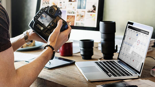 A photojournalist trying to find a specific image to use