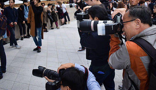Freelance and agency photographers taking photos for news reports