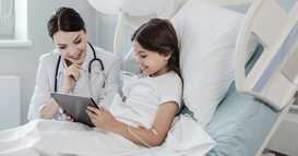 doctor and patient using tablet to watch hospital tv package