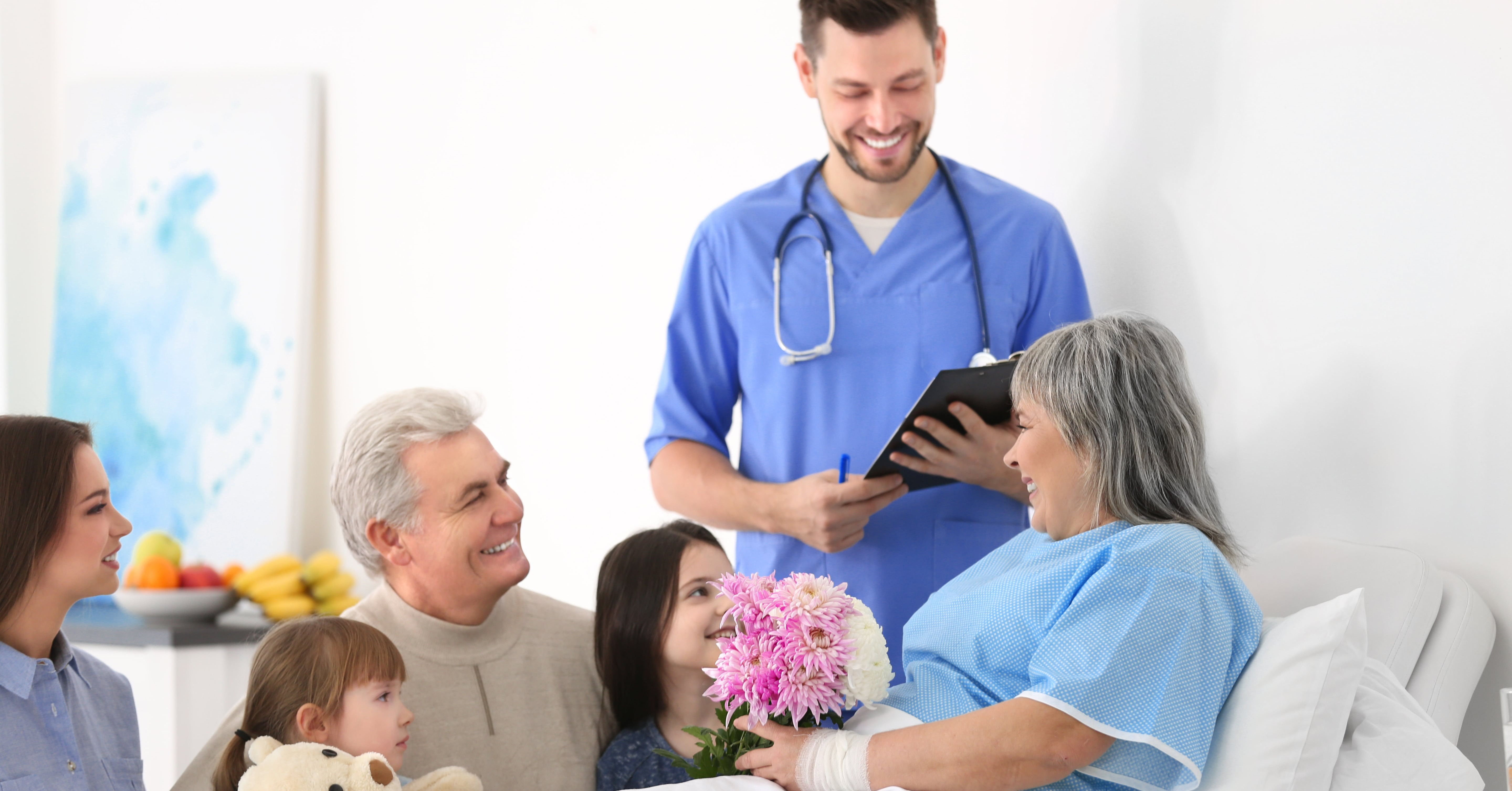 doctor, family and patient in hospital