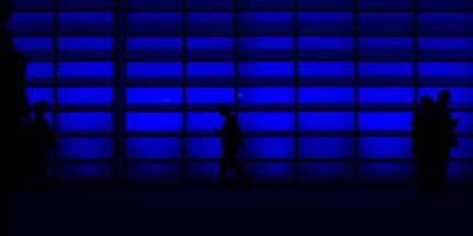 people walking in dark blue office data privacy