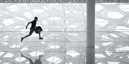 man running to work with briefcase