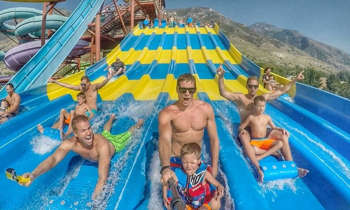 Family enjoying Seven Peaks Resorts water slide