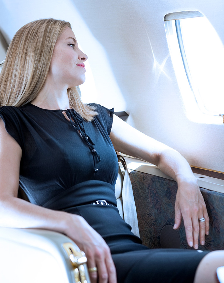 woman sitting on a private jet