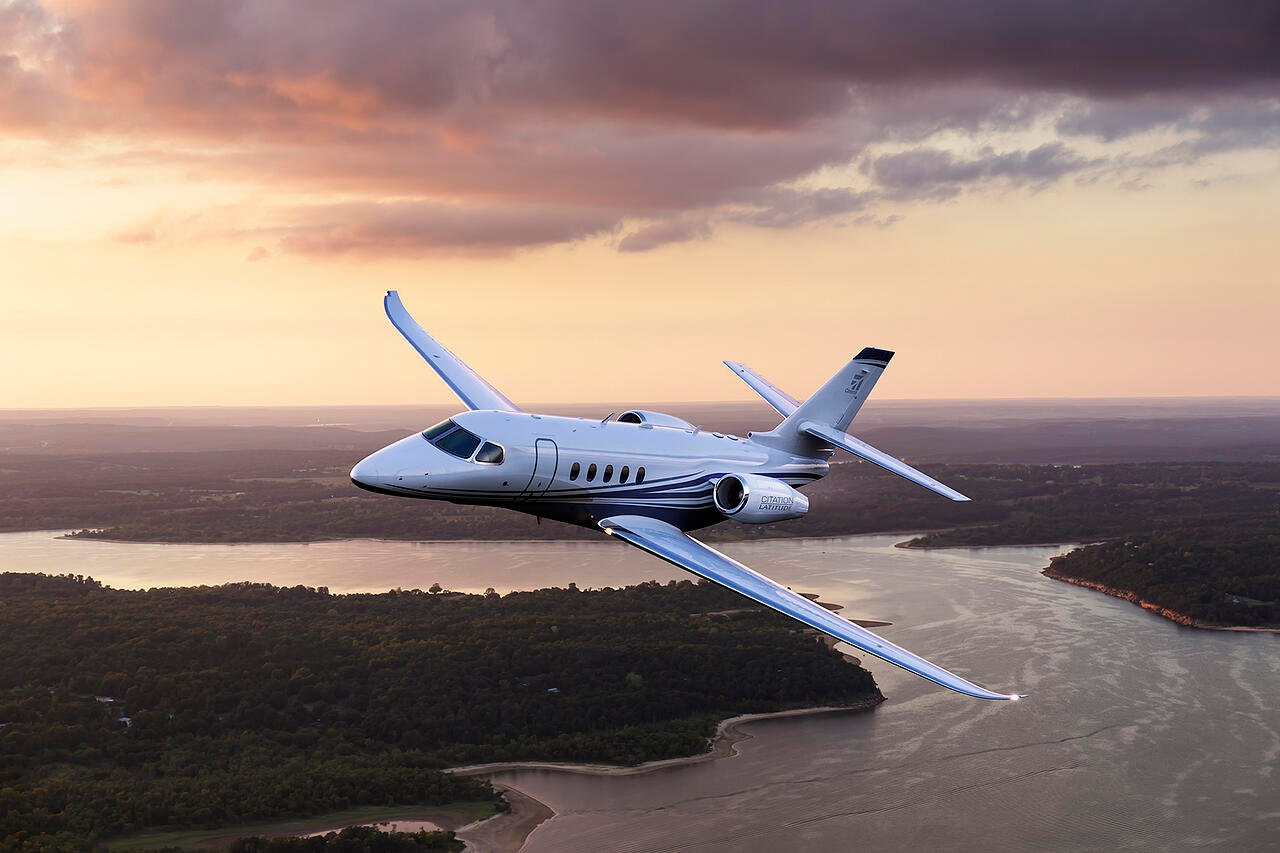 Cessna Citation Latitude private jet flying at dusk