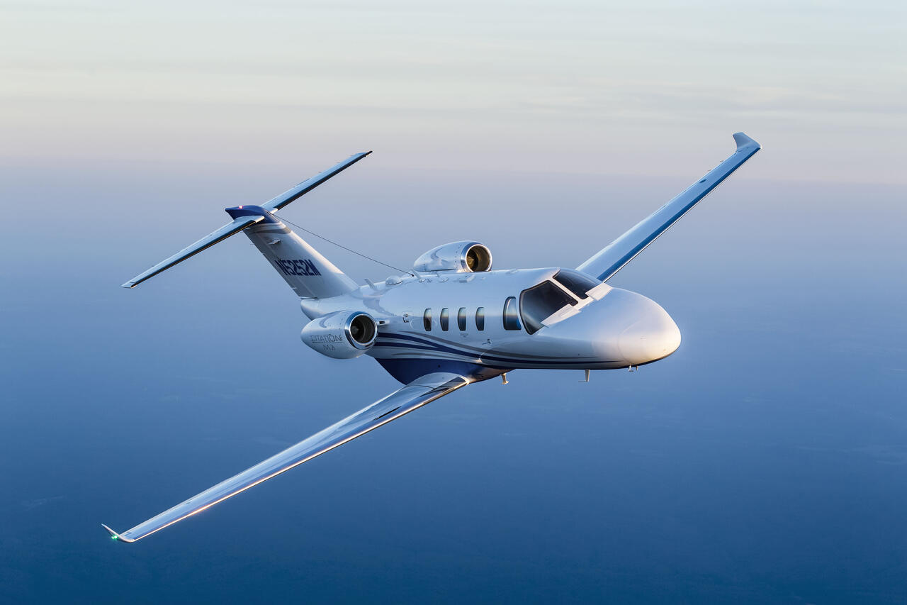 Cessna Citation M2 flying over water