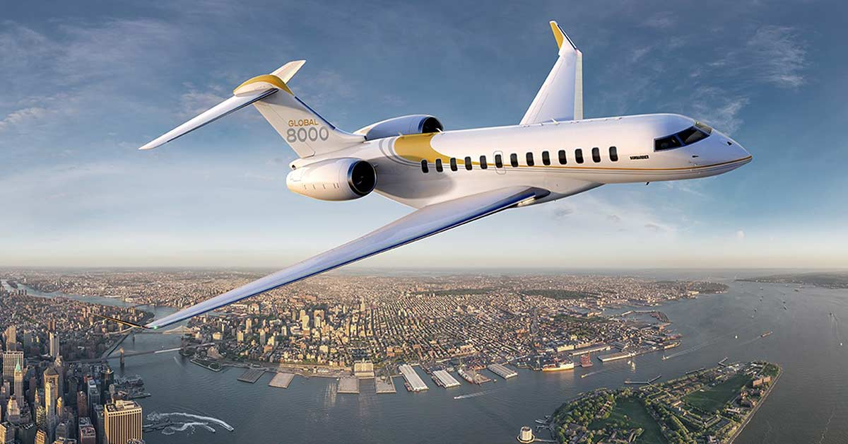 bombadier Global 8000 flying over a city