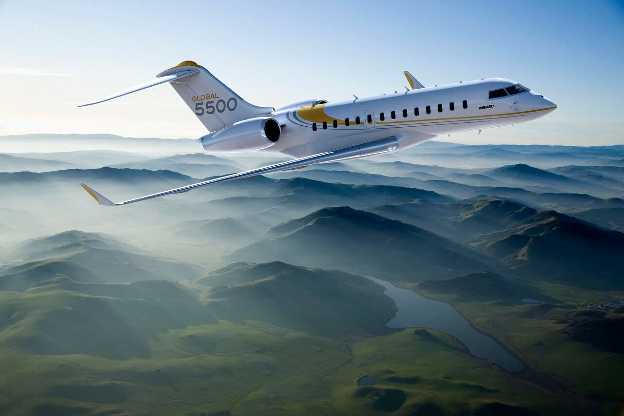 bombardier global 5500 flying over mountains