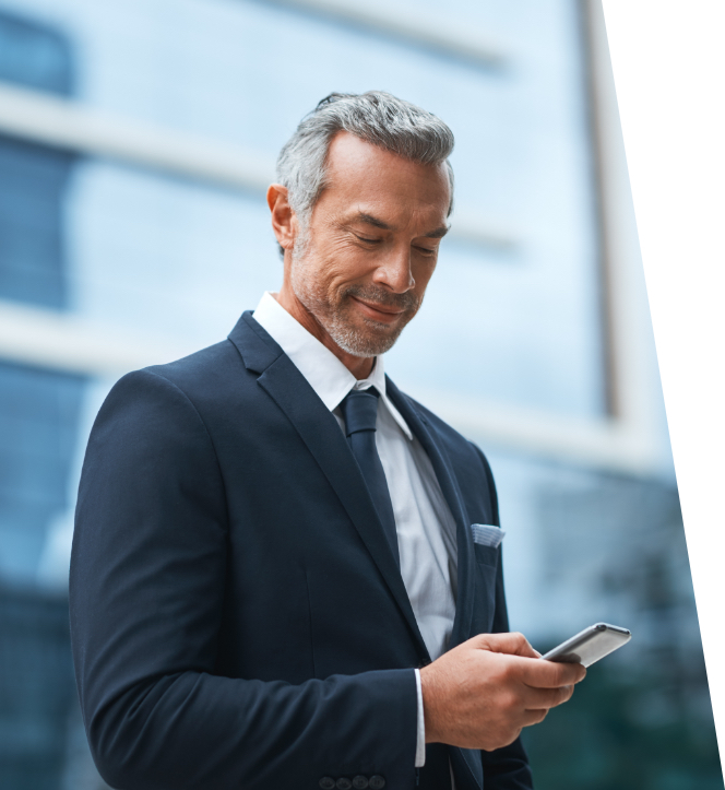 man checking phone getting update about private jet financing
