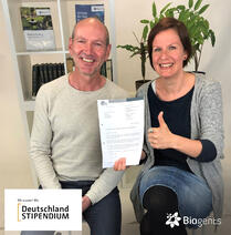 "As former biology students of the University of Regensburg our co-founder & member of management board Dr. Martin Geier and our HR manager Dr. Ulla Gordon are pleased about the ""Deutschlandstipendium"" scholarship grant from the company Biogents."