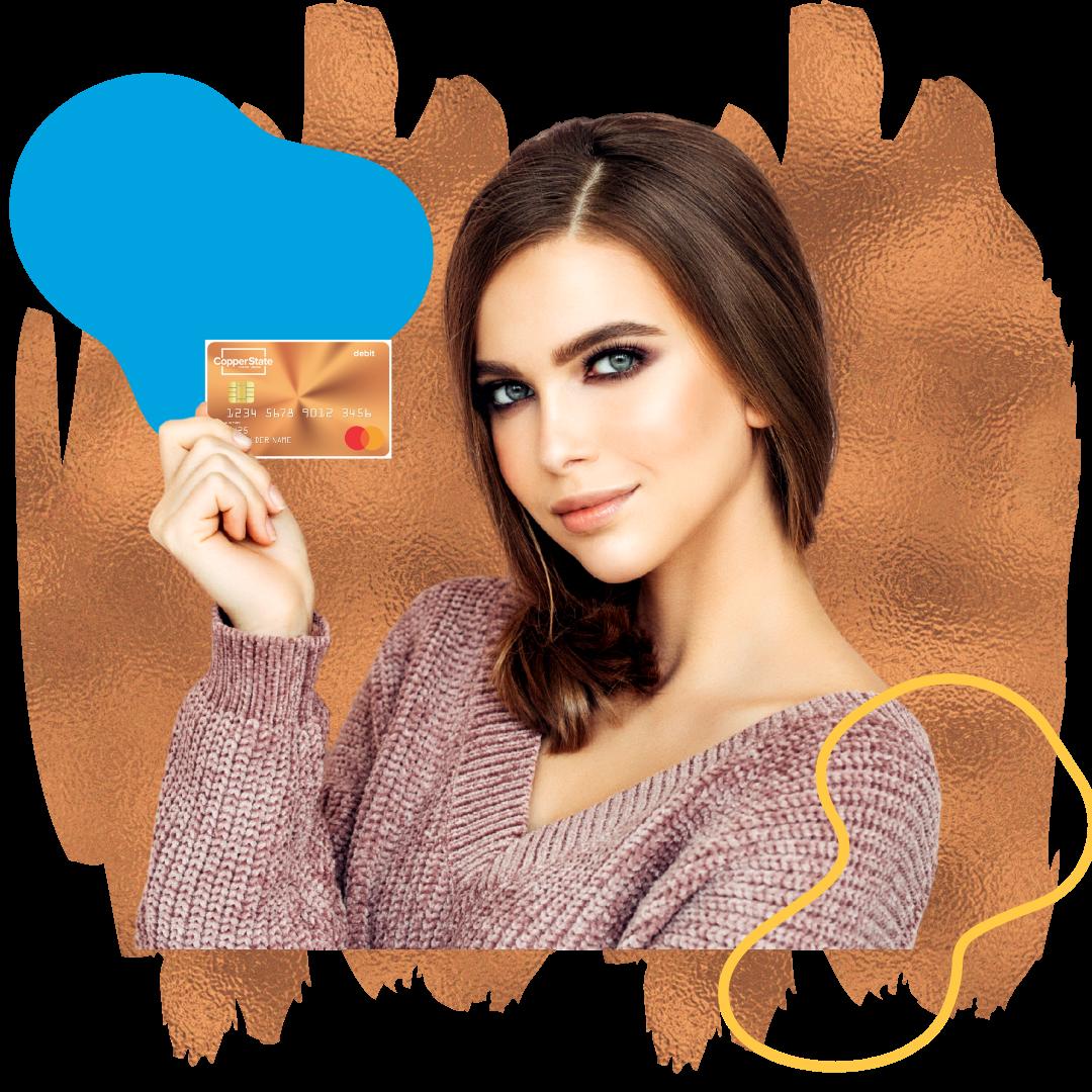 Woman holding Copper State CU debit card