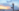 Girl performing gentle yoga on the beach
