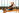 graphich man performning pilates for beginners on a pilates mat
