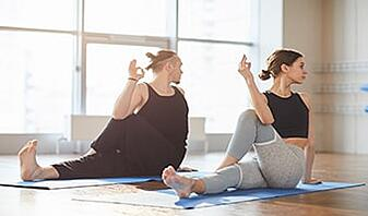 couple making marichis pose doing yoga 101 together