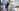 girl standing infront of desk stretching participating in workplace wellness program