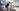 girl standing in front of desk stretching participating in workplace wellness program