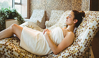 how to calm down woman relaxing while lying down