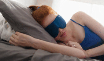 Red headed girl sleeping on the bed using Yoga Nidra For Sleep to help her sleep