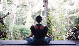 woman in sitting yoga pose during kundalini yoga practice