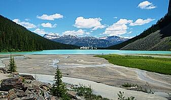 mindfulness using nature therapy at Lake Louise amongst the mountains and chateau