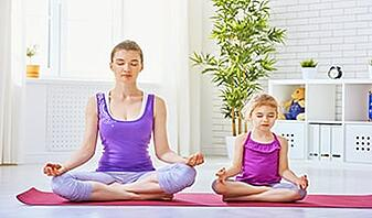 mother and daughter doing yoga for beginners
