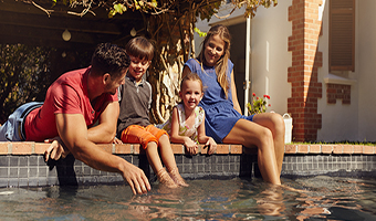 relax your mind family relaxing by the pool, destressing today