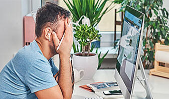 stress management, man feeling stressed at work