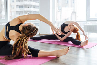 two girls doing private yoga lessons one on one yoga class