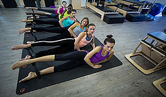 what is pilates group of women exercising with pilates ring