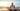 woman doing-gentle yoga on the beach