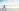woman doing yoga on the beach near the water