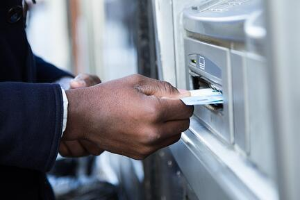 close-up-of-man-taking-cash-from-atm
