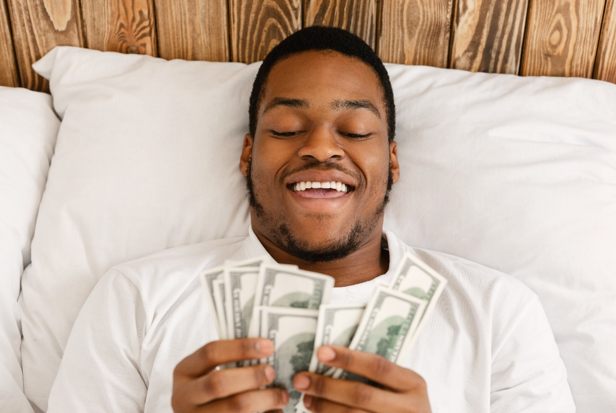 happy-man-counting-and-changing-his-money-mindest