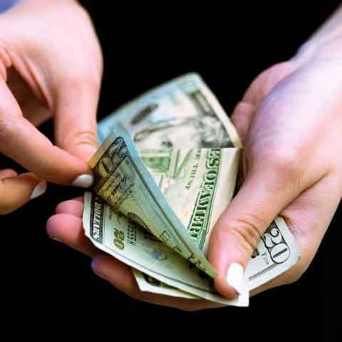 woman-holding-twenty-dollar-bills
