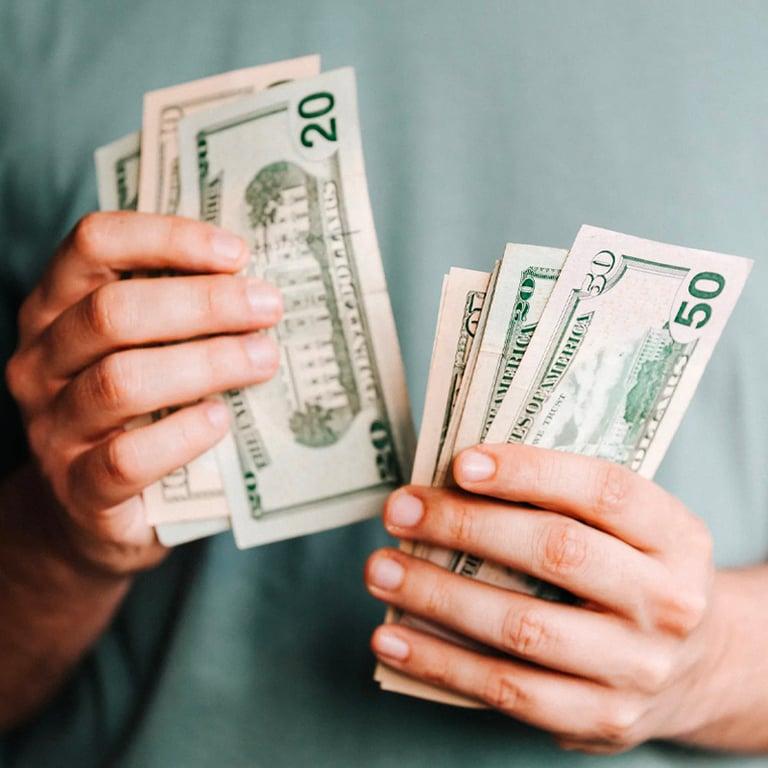Crop Man Counting Dollar Bank Notes