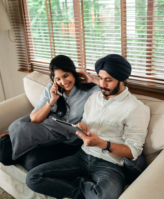 Happy ethnic couple using tablet