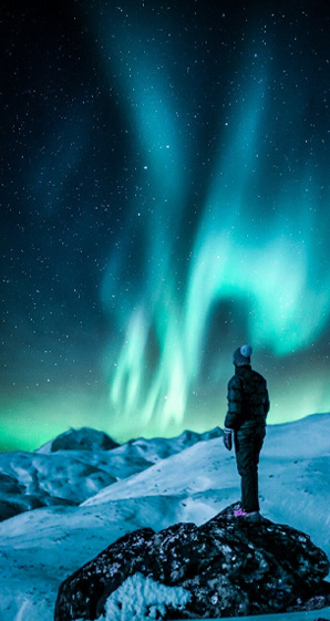man standing near snowfield
