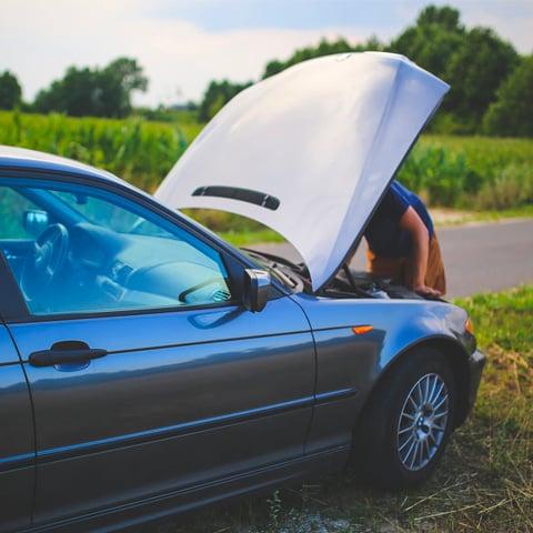 person repairing car