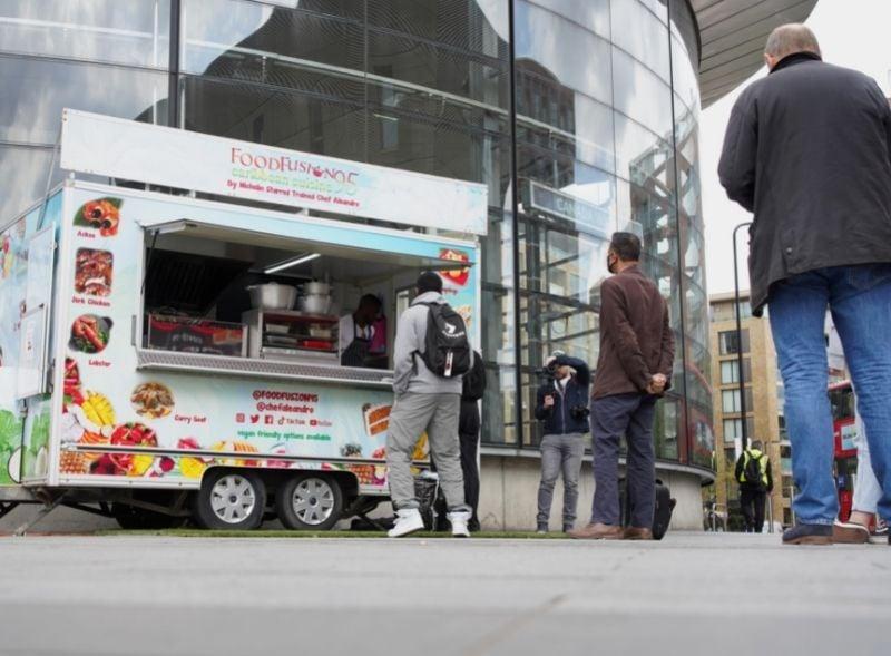 Food Fusion street food trailer serving customers