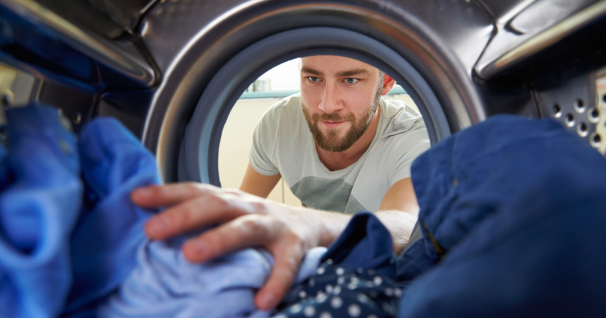 Man doing laundry in order to prevent jock itch