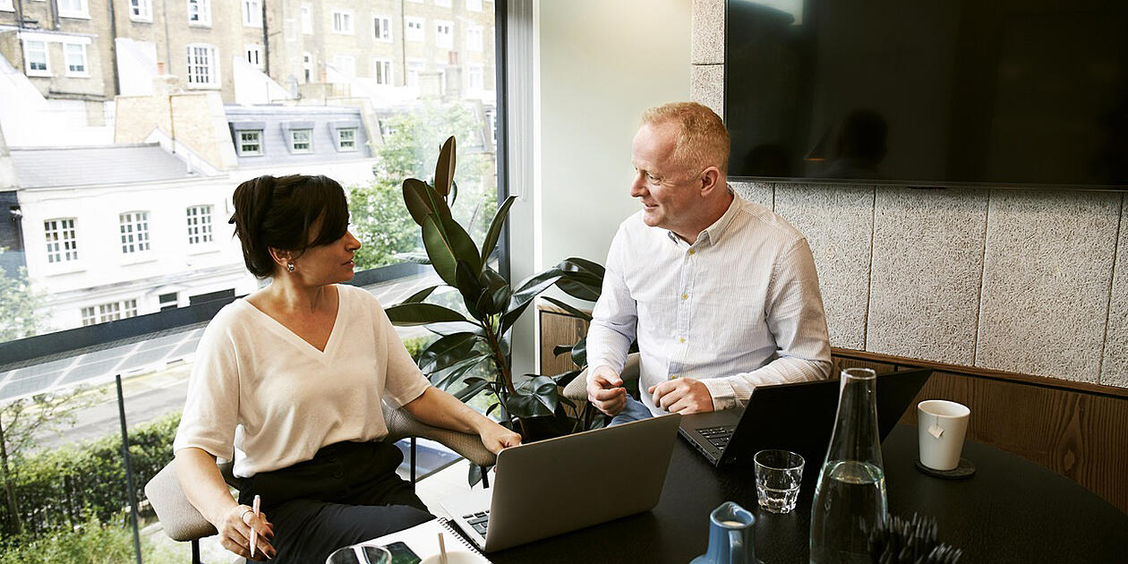 man and woman in office