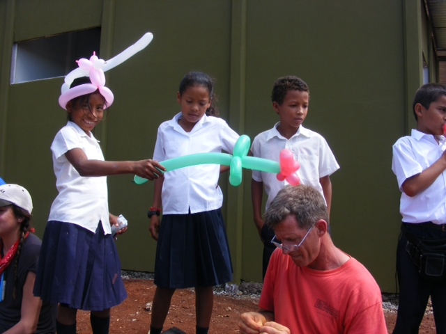 Local Kids playing with ballon animals made by Global Village Team