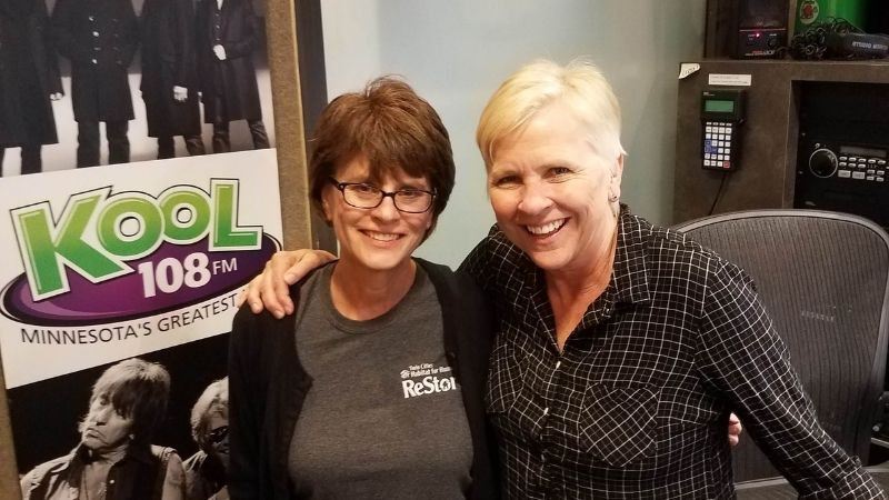 Robin with Lee Valsvik of Kool 108 FM in Lee's office.