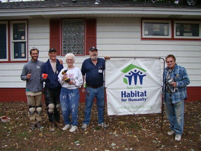 The JCRC Reg Crew with a Habitat for Humanity sign.