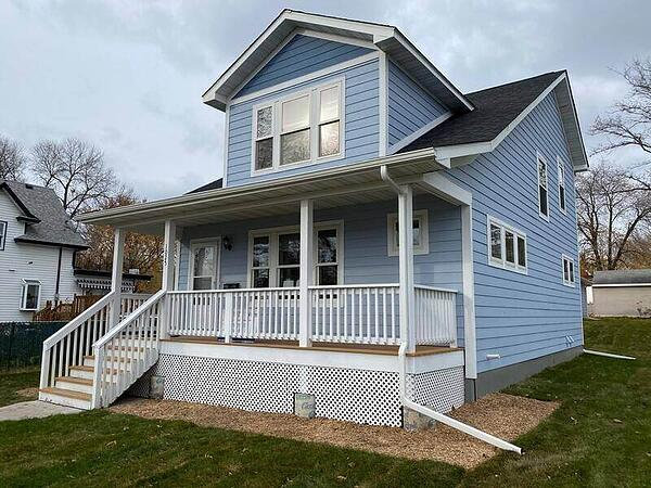 A blue finished Habitat home.
