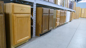 A row of cupboards and cabinets.
