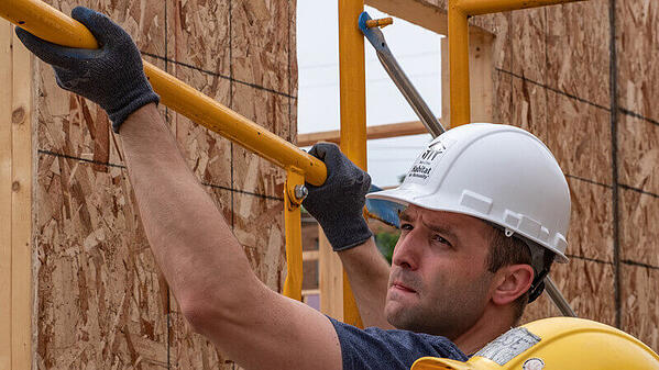 Campaign Council member Jake Loesch volunteering on a Habitat build site