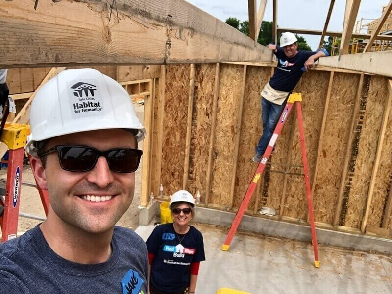 Jake poses with Representative Kristin Robbins (R-Maple Grove) and Representative Michael Howard (D-Richfield) at the Red Blue Build.
